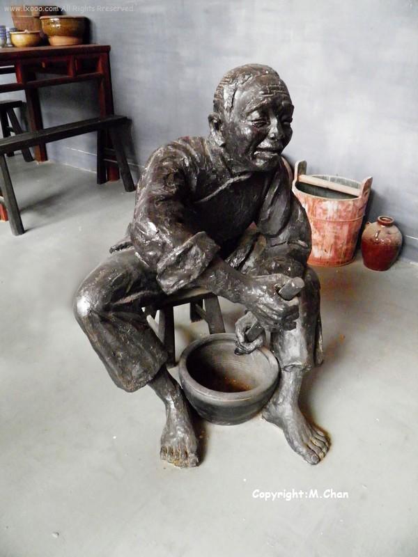 擂咸茶铜雕